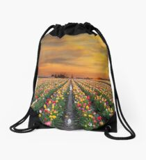 Sunset over colorful Tulip flower fields in full bloom during spring season tulip festival in Woodburn Oregon Drawstring Bag