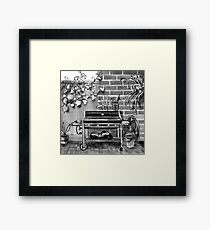 Barbecue and bucket in a back yard Framed Print