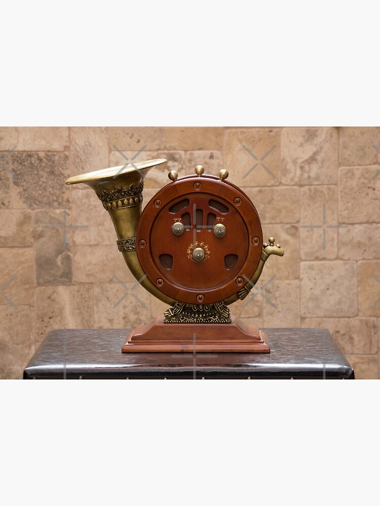 Antique round wood AM/FM radio with brass horn ornate speaker on pedestal on table by kpander