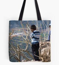 Children playing on the edge Tote Bag