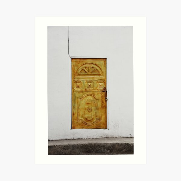 Golden yellow door in white wall Art Print