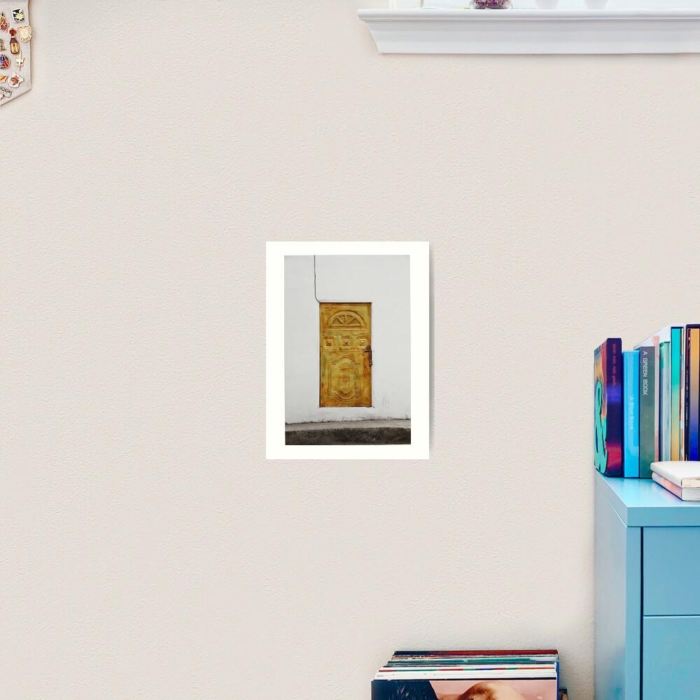Golden yellow door in white wall Art Print