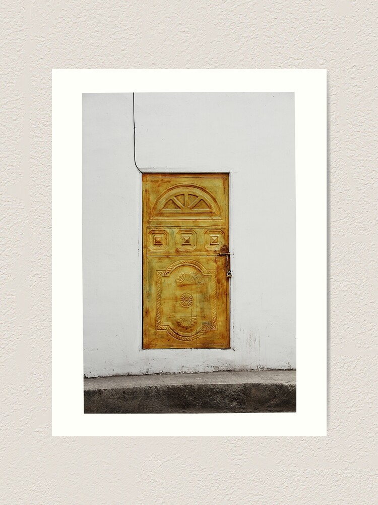 Alternate view of Golden yellow door in white wall Art Print