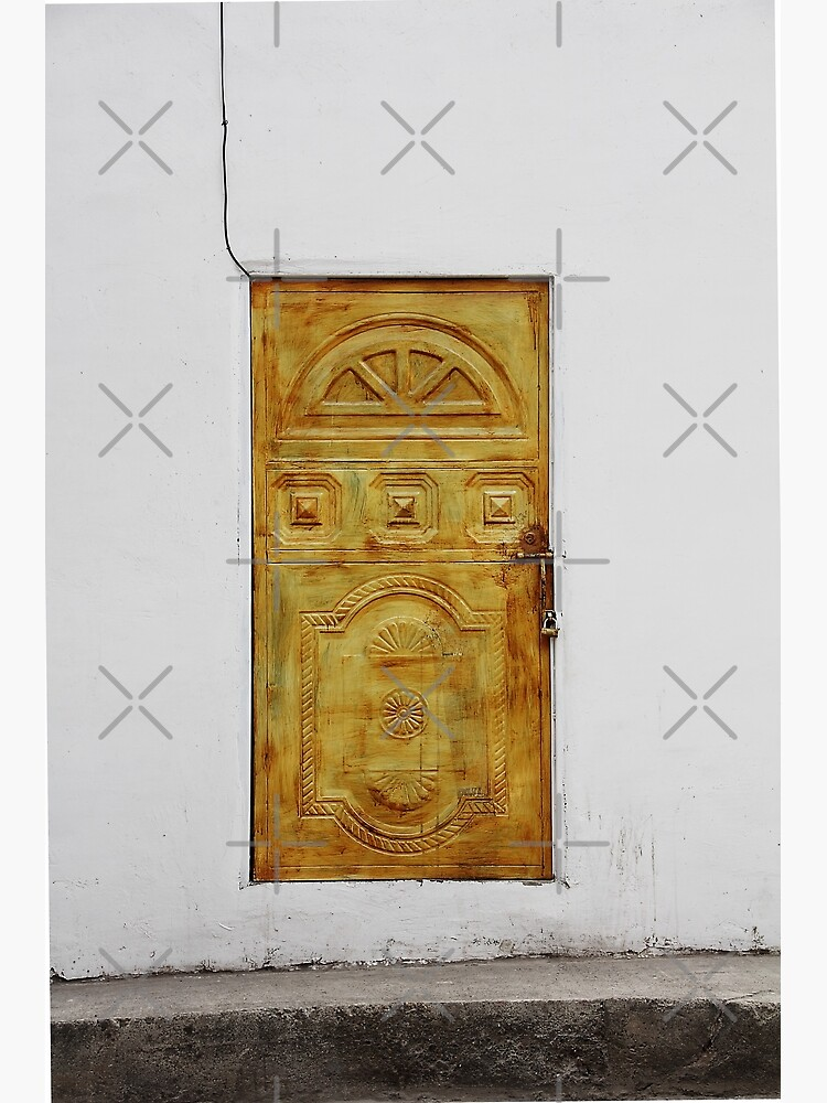 Golden yellow door in white wall by kpander