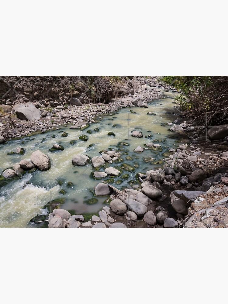 Green rushing water over rocks at base of valley, Sibambe, Ecuador by kpander