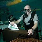 Extreme underwater ironing by Andrew Newton