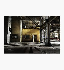 Yellow brick wall outside control room in abandoned industrial coal power station with open door and steel columns Photographic Print