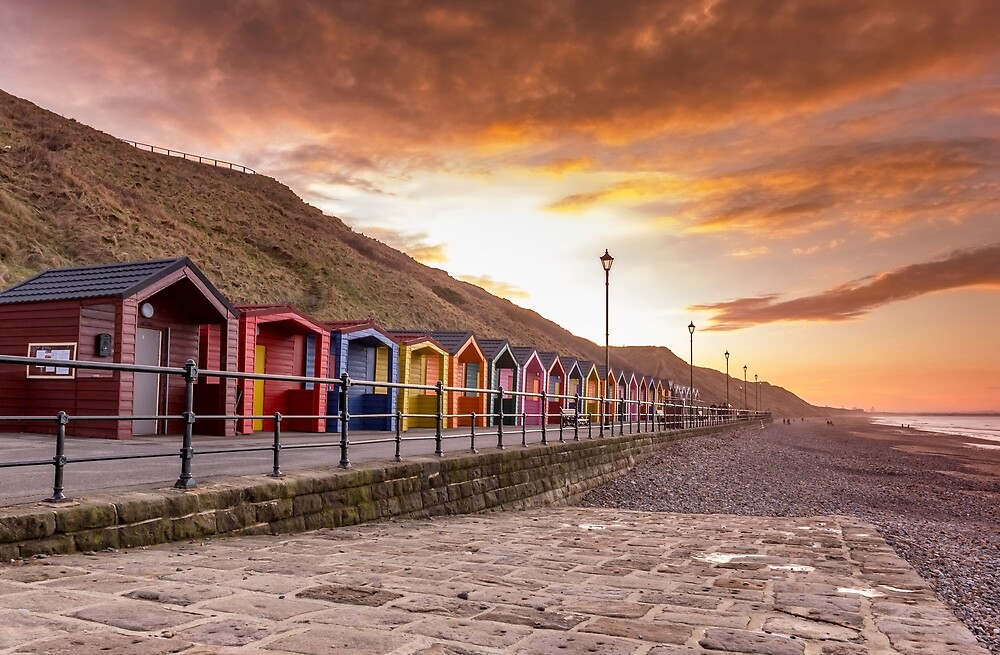 Saltburn beach huts at sunset by grumpykeith