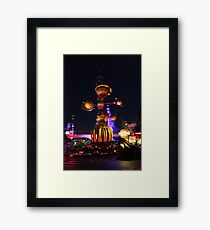 Tomorrowland Astro Orbitor at Night Framed Print