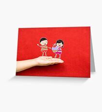 boy and girl with cupcake on a hand Greeting Card