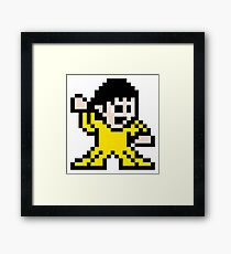 Pixel art inspired art of Bruce Lee Framed Print