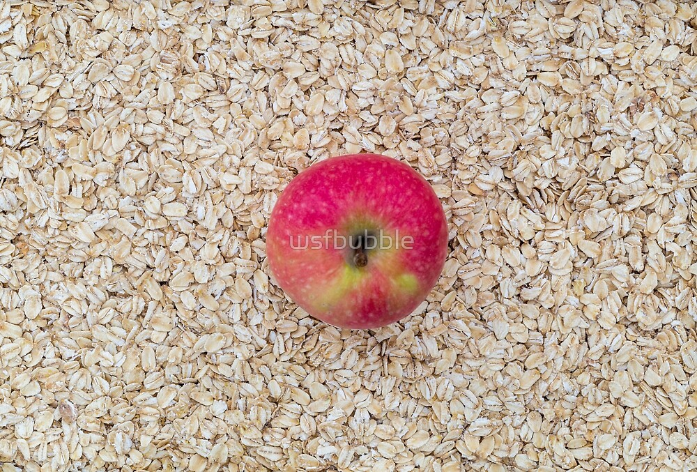 Apple on oatmeal as a background by wsfbubble