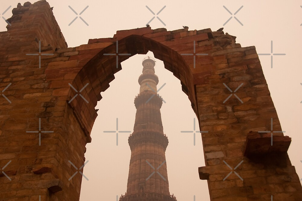 Cross section of the Qutub Minar framed within an archway in foggy weather by ashishagarwal74