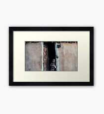 Children from Himba tribe (Namibia) in the door of his house Framed Print