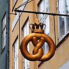 Crowned Pretzel Sign in Copenhagen, Denmark by Catherine Sherman