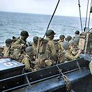 An assault unit finishes boarding a barge. Many GIs wear the D-Day's characteristic vest. World War II. by Marina Amaral