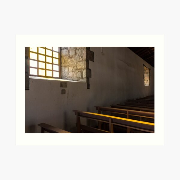 Soft light from window well on to church pews, through stone block wall, Colta, Ecuador Art Print