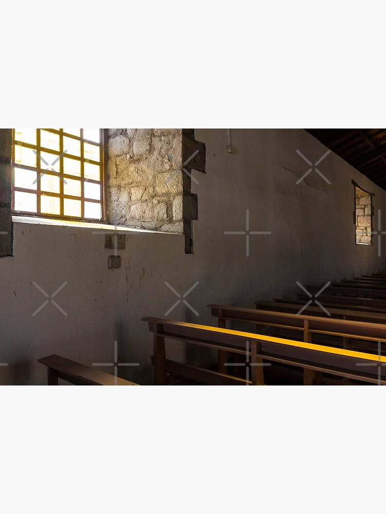 Soft light from window well on to church pews, through stone block wall, Colta, Ecuador by kpander