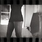 Young lady in bedroom 35mm analog silver gelatin photograph by edwardolive