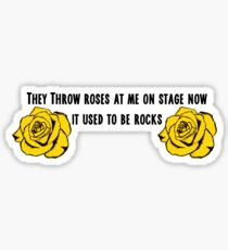 MGK- they throw roses at me now on stage, it used to be rocks Sticker