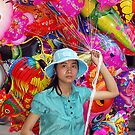 Balloon Seller - Hanoi, North Vietnam by Bev Pascoe