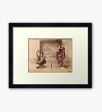 Two geisha girls dancing Framed Print
