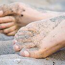 Barefeet in sand by Arve Bettum
