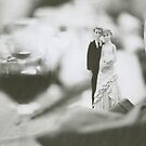 Bride and groom cake topper wedding marriage banquet black and white analog 35mm film photo by edwardolive