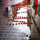 Lanterns in the puddle / London Chinatown  by Zohar Manor-Abel