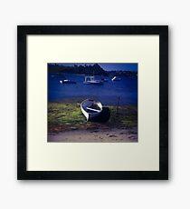 Boat on a lake Framed Print