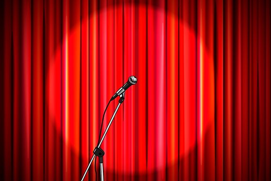 Bright red curtain with shiny microphone by BestPics