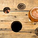 Glass of Craft Beer on Wood by katevernaphoto