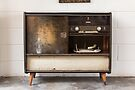 Antique record player turntable and stereo unit by Kendall Anderson