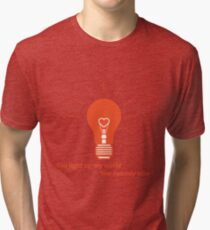 Glowing light bulb with glower in shape of heart. Tri-blend T-Shirt