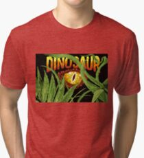 Eye of a dinosaur in the jungle. Imitation of embroidery Tri-blend T-Shirt