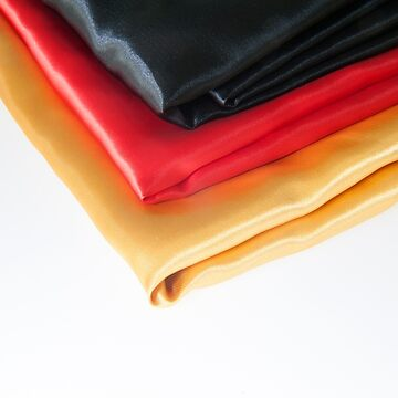 Photo Satin Textile colours of the German flag by stuwdamdorp