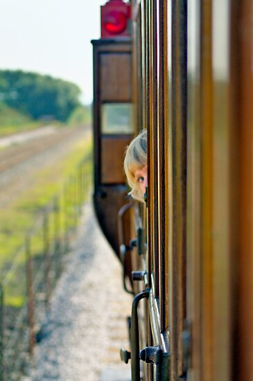 Train child portrait by Andrew Howson