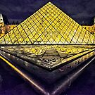 The Pyramid at the Louvre in Paris, France, at night by cclaude