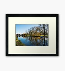 Scenic views over the still waters of the Causeway at Godmanchester Framed Print