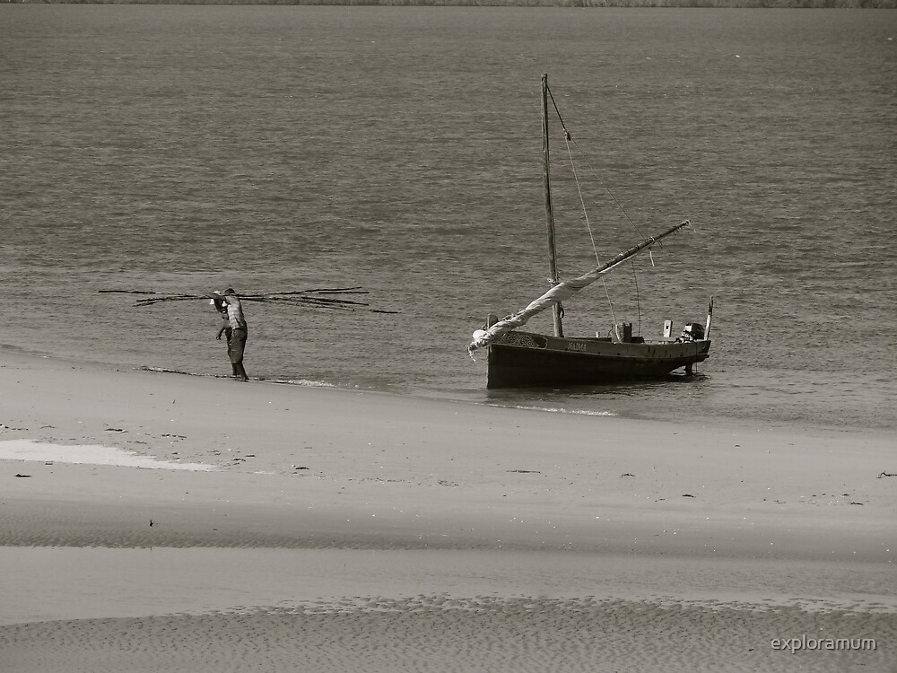 Lamu Island - wooden fishing dhow getting unloaded - Black and White by exploramum
