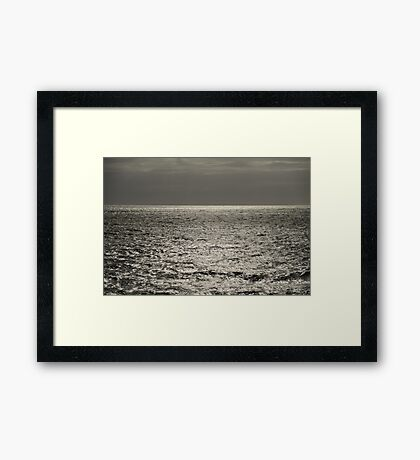 Sea shimmering in the sun Framed Print