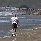 Man Running on the Beach by Buckwhite