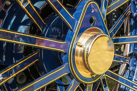 Brass and blue traction engine wheel by Chris Warham