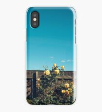 Yellow flowers over a wooden fence iPhone Case/Skin