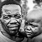 Pygmy Father & Child by Melinda Kerr