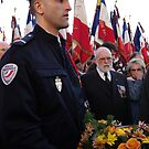Police man holding a wreath by imogen