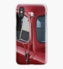 Clown Head Antennae Topper on a Red Car iPhone Case