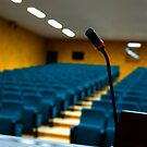 Microphone in an empty auditorium by mrfotos
