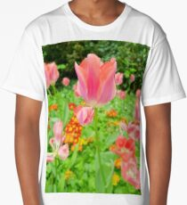Pink tulips on a flower bed Long T-Shirt