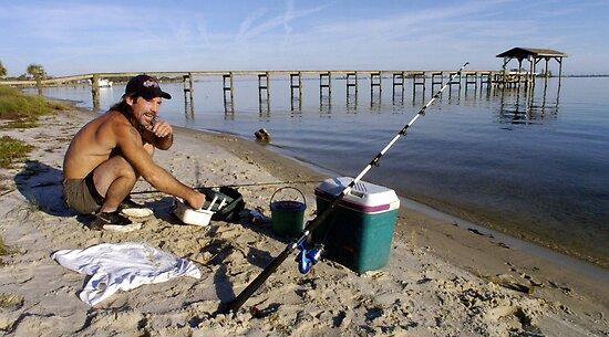 Shore fisherman by Larry  Grayam